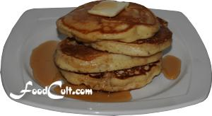 stack of pancakes with butter and maple syrup